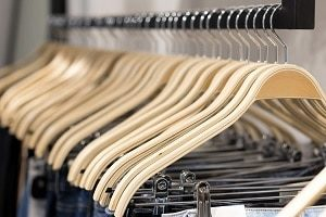 Hanging Jeans on Wooden Hangers for Retail Display