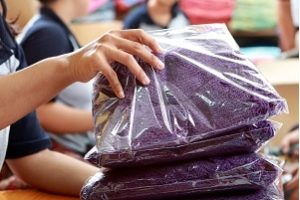 Garment Reprocessing Packing Garments in Ireland for Shipping to Retailers