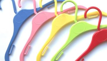 Hanging Kids Clothes on Colourful Hangers
